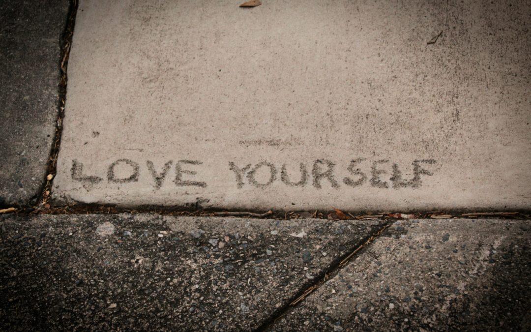 Sidewalk with wording Love Yourself